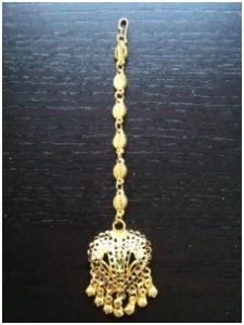 Pann smycke i guldmetall